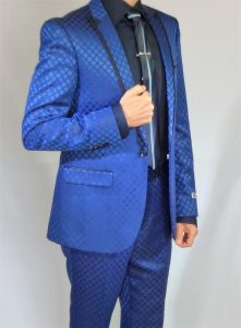 Blue checker suit with Black shirt and tie.